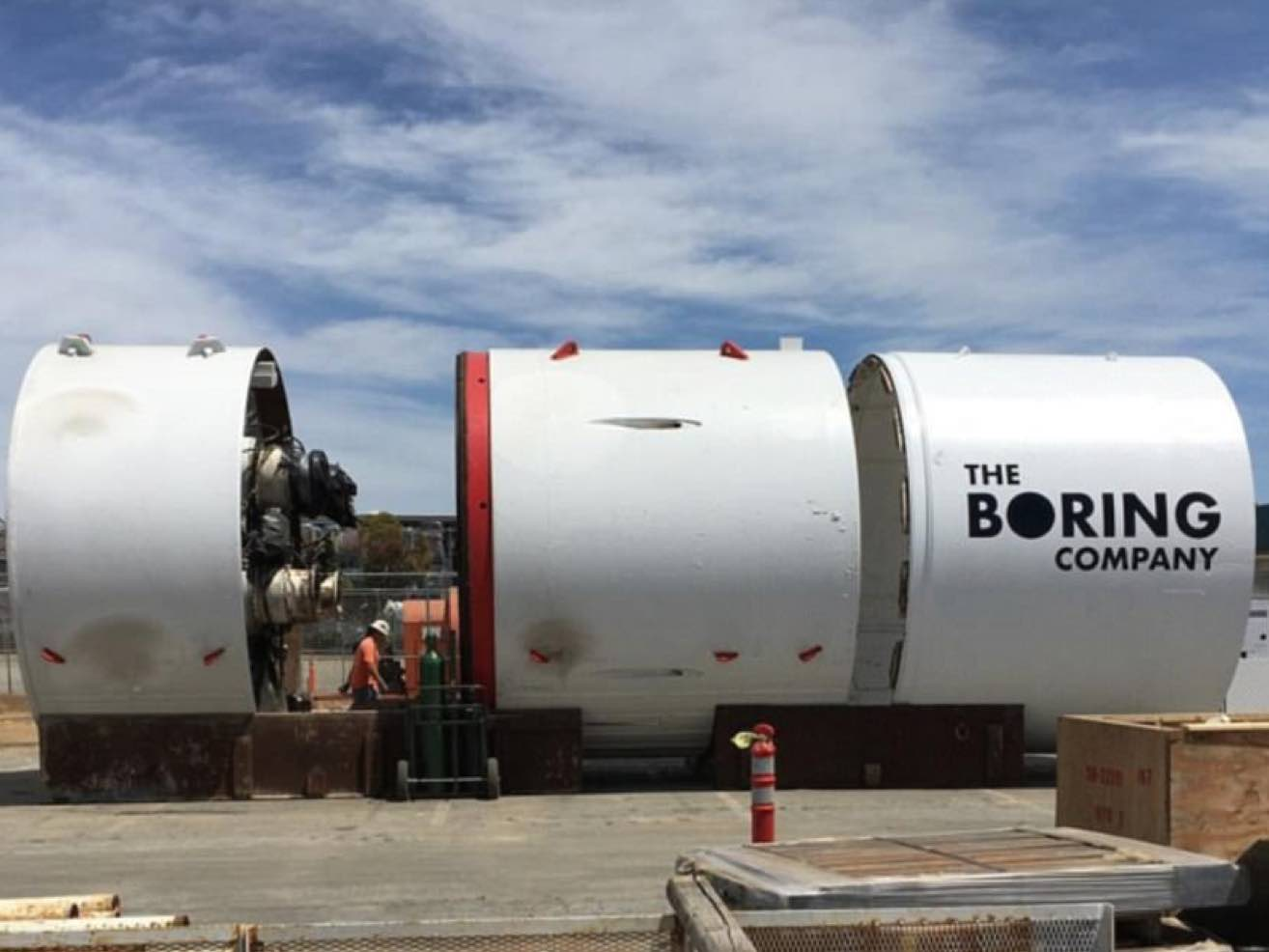 old tunnel boring machine juxtaposed with elon musk's boring company machine
